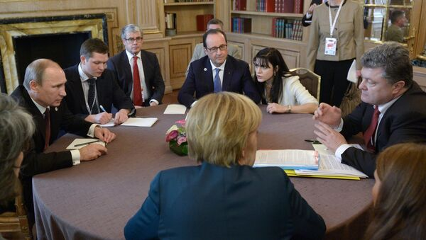 Angela Merkel, Vladímir Putin, François Hollande y Petró Poroshenko durante la cumbre del Cuarteto de Normandía (archivo) - Sputnik Mundo