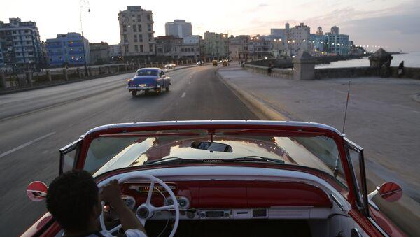 Michel Salgado drives his 1957 Mercury Monterey convertible along the Malecon in Havana, Cuba - Sputnik Mundo