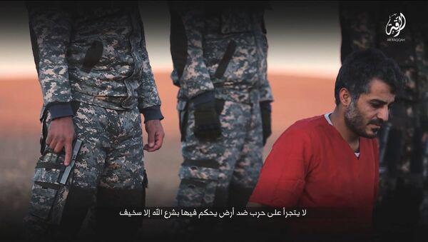 Uno de los rehenes ejecutados por Daesh - Sputnik Mundo