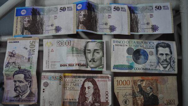 Pesos colombianos (archivo) - Sputnik Mundo