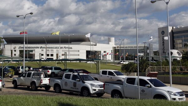 Police vehicles are parked outside the headquarters of the South American soccer confederation known as CONMEBOL in Asuncion, Paraguay, Thursday, Jan. 7, 2016 - Sputnik Mundo