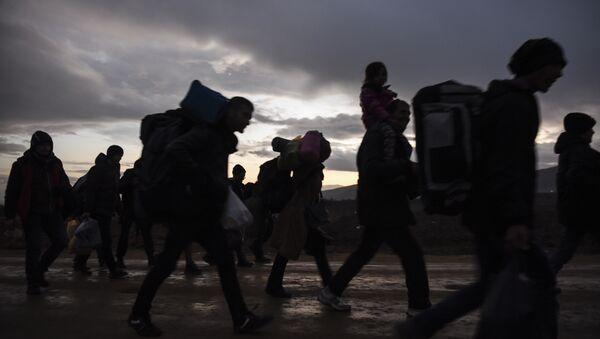 Migrantes - Sputnik Mundo