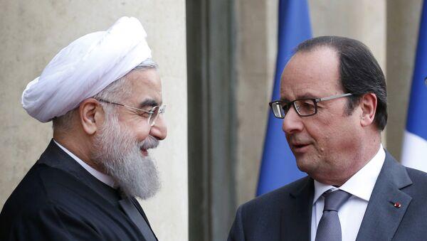 El presidente de Irán, Hasán Rohani, y el presidente de Francia, François Hollande - Sputnik Mundo
