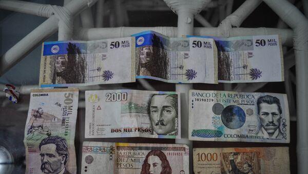 El peso, la moneda de Colombia (archivo) - Sputnik Mundo