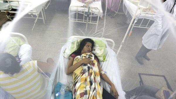 Пациентка с лихорадкой, вызванной вирусом Зика, в больнице Парагвая - Sputnik Mundo