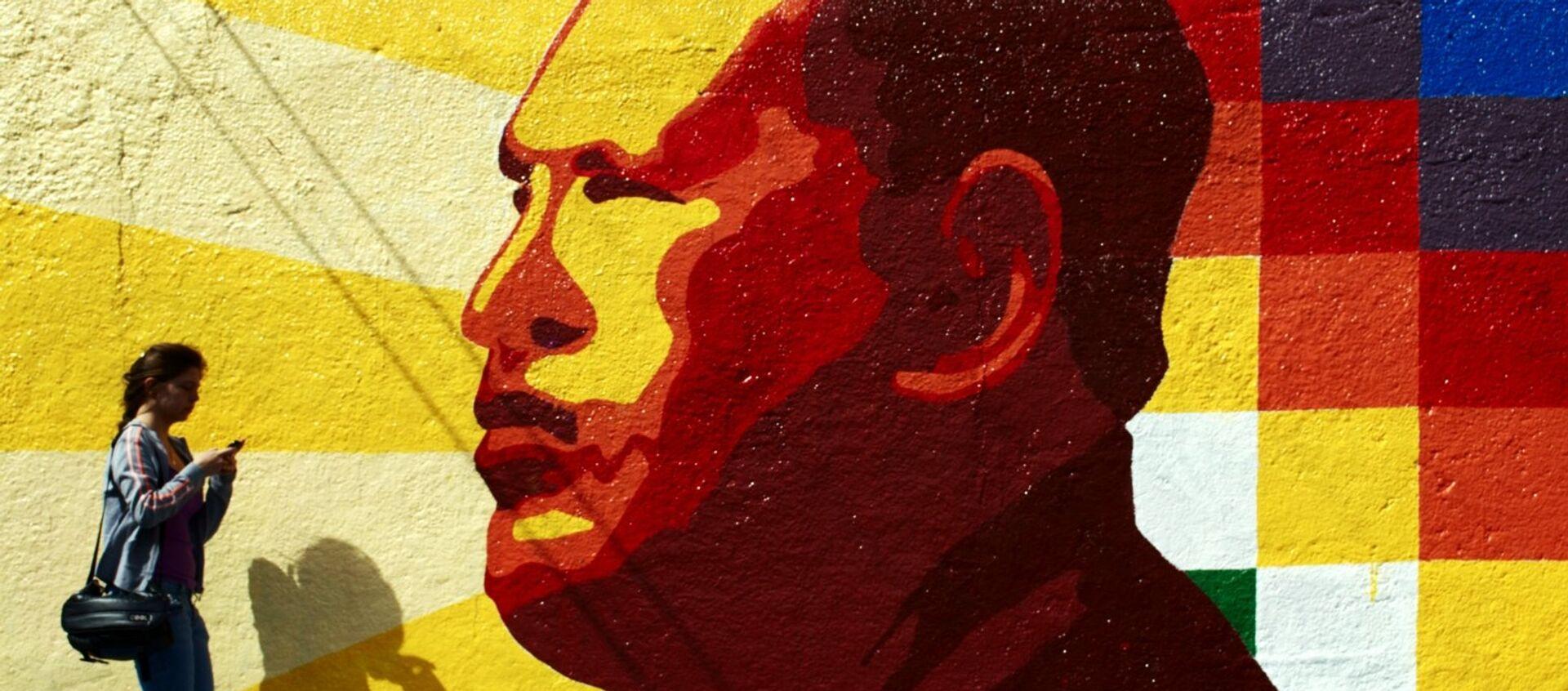 Graffiti con un retrato de Hugo Chávez - Sputnik Mundo, 1920, 05.07.2019