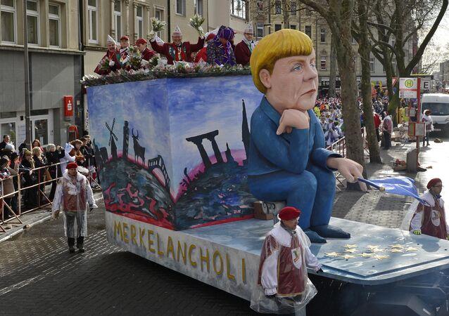 Figura de Angela Merkel durante el Carnaval de Colonia