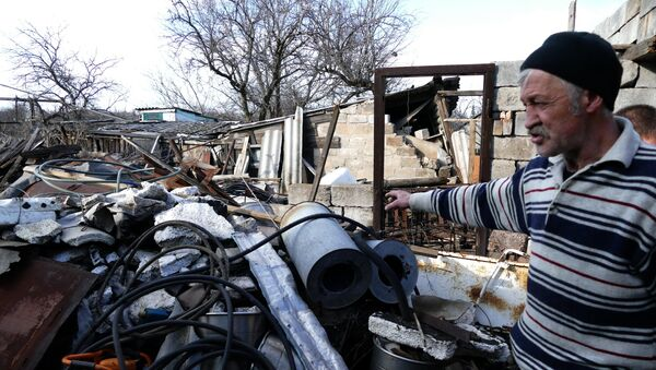 Casa destruida en la región de Donetsk - Sputnik Mundo