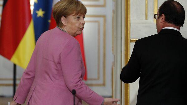 Canciller de Alemania, Angela Merkel y presidente de Francia, François Hollande - Sputnik Mundo