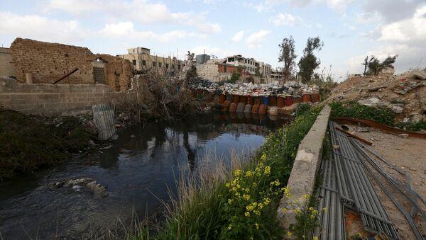 Edificios destruidos cerca de Damasco, la capital de Siria - Sputnik Mundo