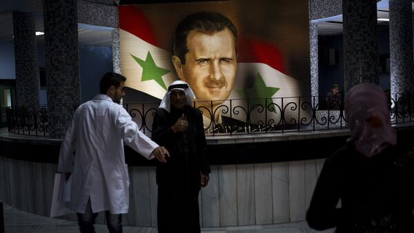 Retrato de Bashar Asad, presidente de Siria, en el Hospital de Damasco (archivo) - Sputnik Mundo