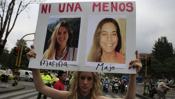 A woman holds a sign during a rally called March of Whores to protest against discrimination and violence against women on International Women's Day in Bogota, Colombia - Sputnik Mundo