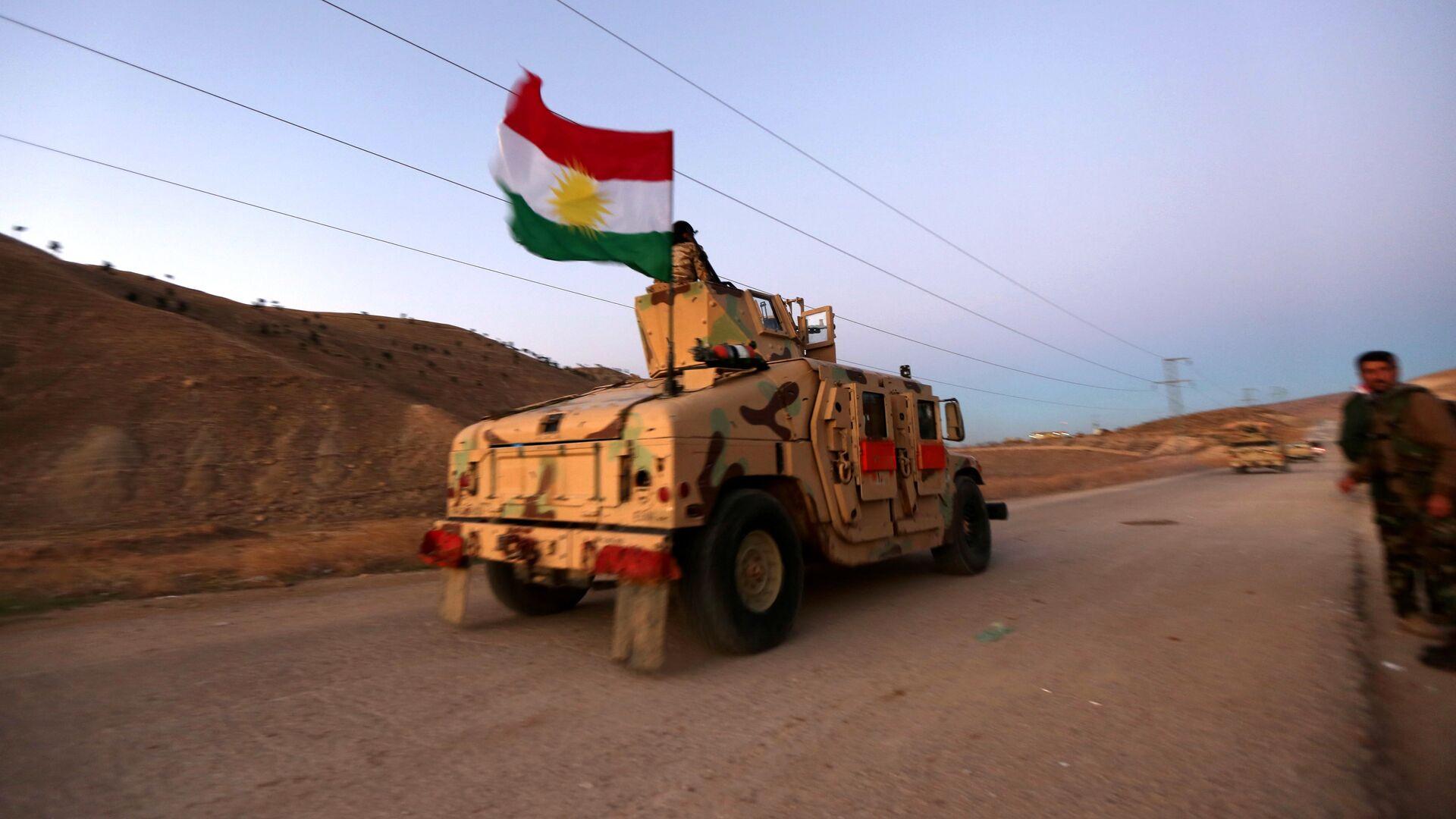 Carro blindado kurdo con la bandera de Kurdistán iraquí - Sputnik Mundo, 1920, 16.04.2021