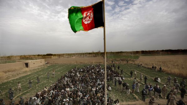 The Afghan national flag is hoisted during an official flag raising ceremony in Marjah on February 25, 2010. - Sputnik Mundo