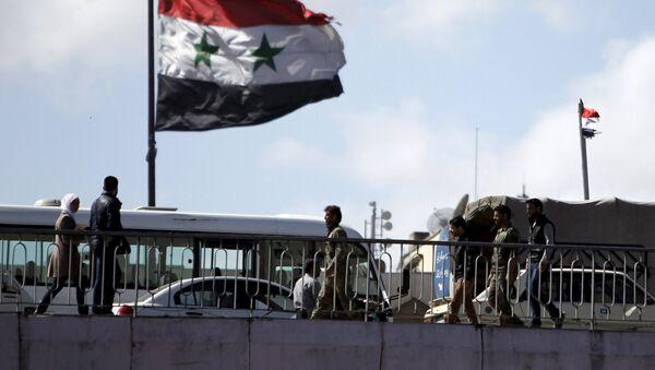 Bandera de Siria en Damasco, 14 de marzo de 2016 - Sputnik Mundo