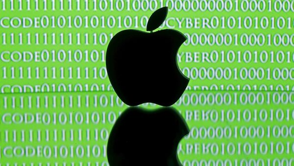 A 3D printed Apple logo is seen in front of a displayed cyber code in this illustration taken February 26, 2016. - Sputnik Mundo