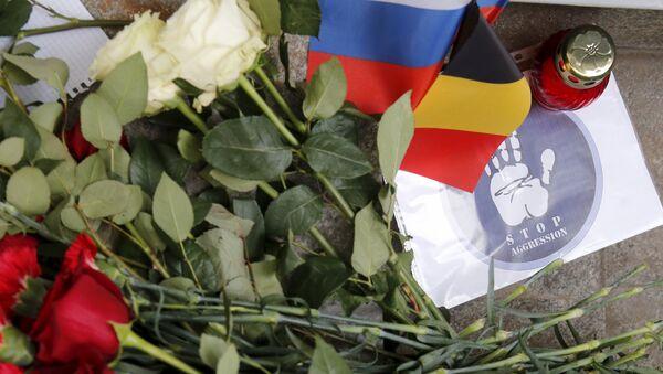 Homenaje a las víctimas de los atentados en Bruselas cerca de la embajada de Bélgica en Moscú - Sputnik Mundo