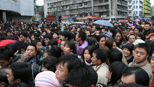 La muchedumbre en la estación ferroviaria de Guangzhou - Sputnik Mundo