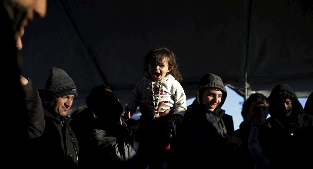 Migrantes y refugiados en la frontera entre Grecia y Macedonia