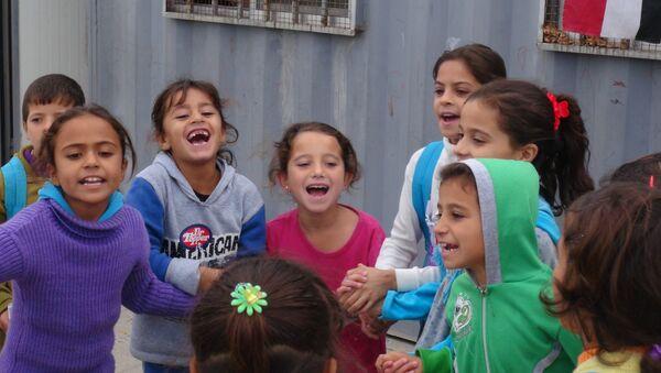 Niños en la ciudad de Palmira - Sputnik Mundo