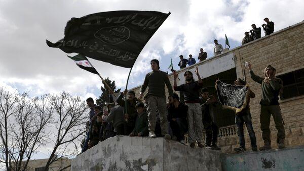 Militantes con banderas extremistas (archivo) - Sputnik Mundo