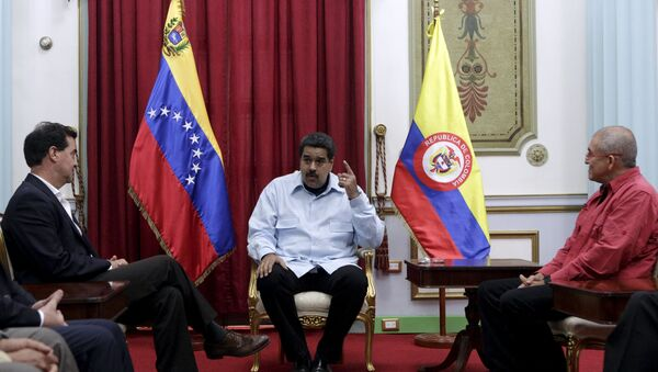 Frank Pearl, representante del Gobierno colombiano, Nicolás Maduro y Antonio García de ELN - Sputnik Mundo