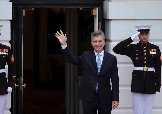 Argentina's President Macri waves as he arrives at the White House