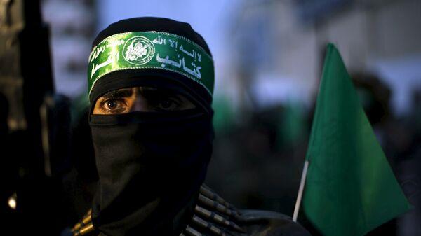 A Palestinian Hamas militant - Sputnik Mundo