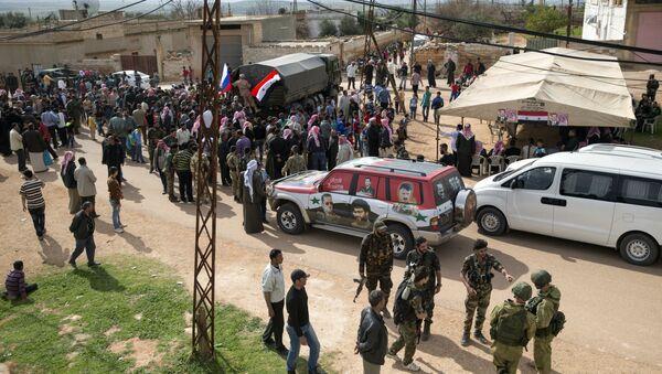 Ayuda humanitaria rusa llega a Hama, Siria - Sputnik Mundo