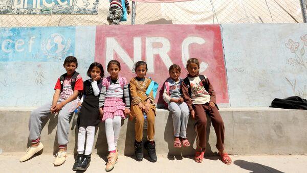 Los niños yazidíes de Sinjar en un campo de refugiados en Irak - Sputnik Mundo