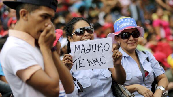 Seguidores de Nicolás Maduro, el presidente de Venezuela - Sputnik Mundo