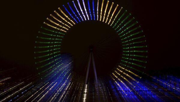 London Eye ('Ojo de Londres'), iluminado en homenaje a los 100 días que faltan para el inicio de los Juegos Olímpicos de Río 2016 - Sputnik Mundo