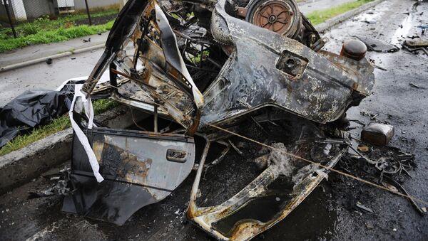 Coche quemado en la región de Donetsk - Sputnik Mundo