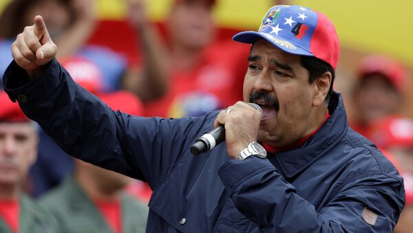 Venezuela's President Nicolas Maduro gestures as he talks to supporters during a rally to commemorate May Day, in Caracas, Venezuela, May 1, 2016. - Sputnik Mundo