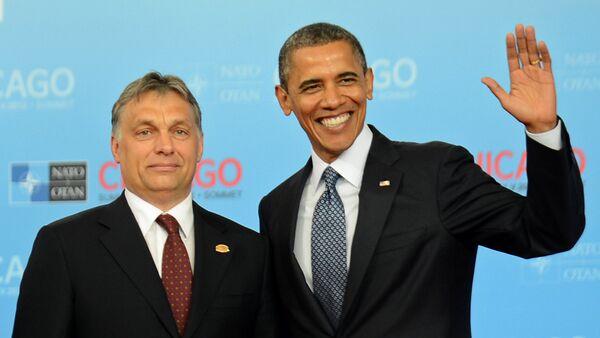 Barack Obama con el primer ministro húngaro Víctor Orban - Sputnik Mundo