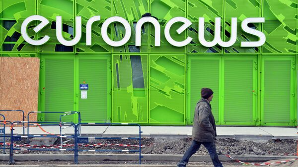 A photo taken on February 6, 2014 shows a man walking past the Euronews building in Lyon's new Confluence district - Sputnik Mundo