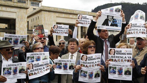 Demonstración en Bogotá para la liberación de la periodista española Salud Hernández Mora - Sputnik Mundo