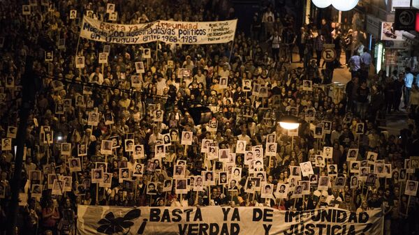 Demonstrators take part in the 20th March of Silence in Montevideo, Uruguay, Wednesday, May 20, 2015.  - Sputnik Mundo