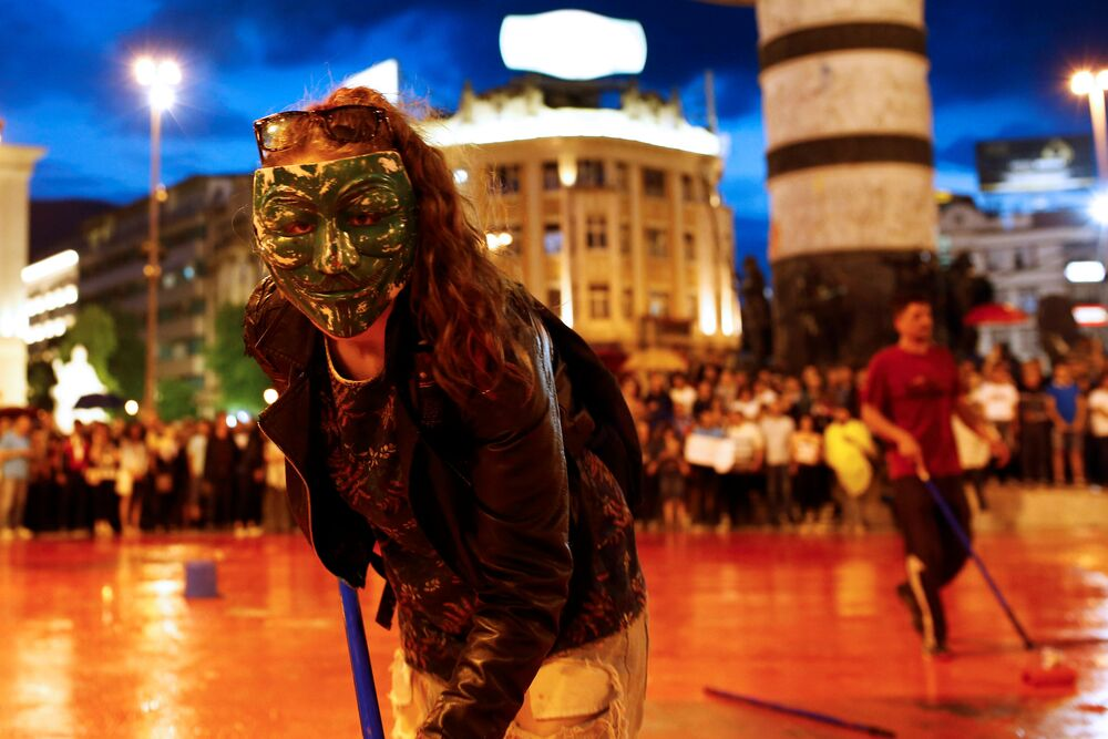 Protesters disperse color paint during a protest against the government, at central square in Skopje, Macedonia June 6, 2016