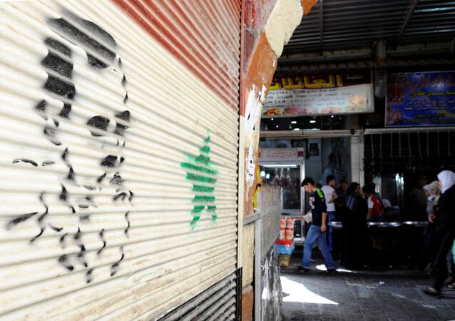 Retrato de Bashar Asad en Damasco