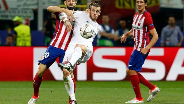 Gareth Bale (centro) - Sputnik Mundo