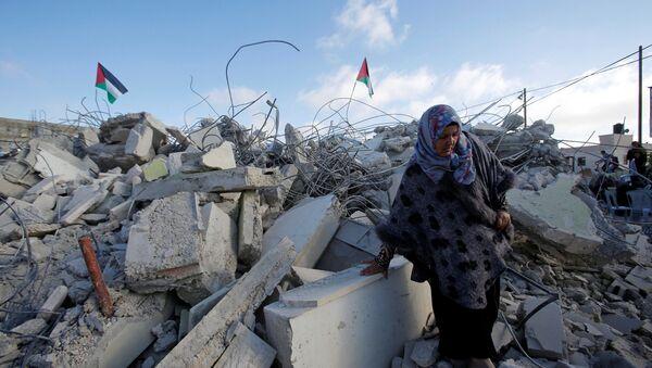 Demoliciones de casas palestinas en Cisjordania - Sputnik Mundo