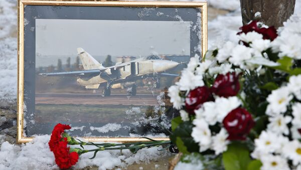 Flowers laid at the monument to pilots in the center of Lipetsk in memory of Lieutenant Colonel Oleg Peshkov of the Lipetsk Air Force Center, the commander of the downed bomber Su-24 - Sputnik Mundo