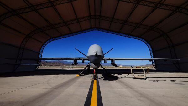 A U.S. Air Force MQ-9 Reaper drone sits in a hanger at Creech Air Force Base - Sputnik Mundo