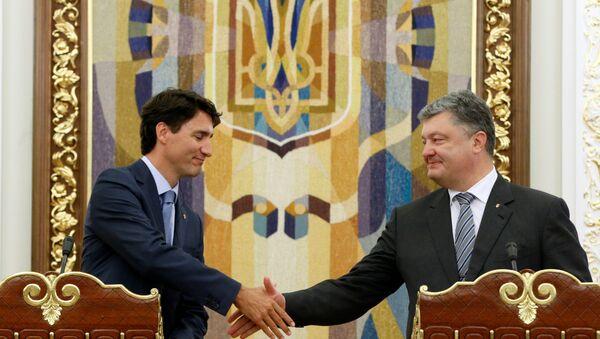 El primer ministro canadiense, Justin Trudeau, y el presidente ucraniano, Petró Poroshenko - Sputnik Mundo
