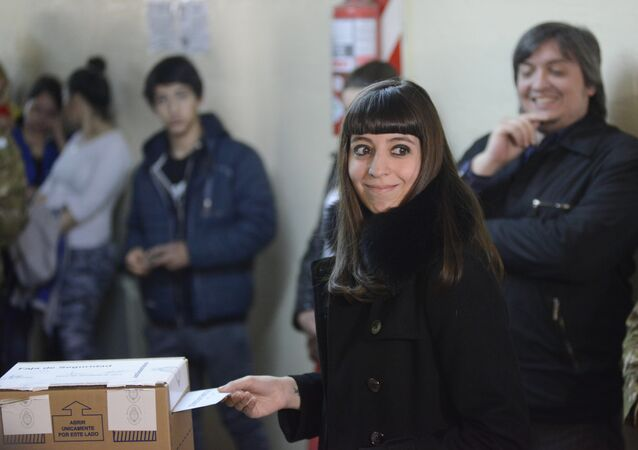 Florencia Kirchner, daughter of Argentina's President Cristina Fernandez, casts her vote during elections in Rio Gallegos, Argentina, Sunday, Oct. 25, 2015
