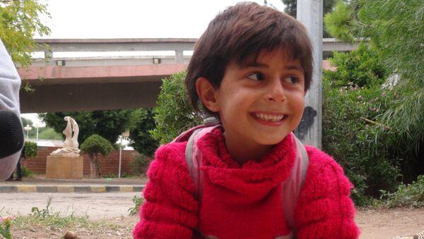 Un niño del liberado barrio Bani Zaid - Sputnik Mundo