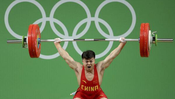 Long Qingquan, atleta de China - Sputnik Mundo