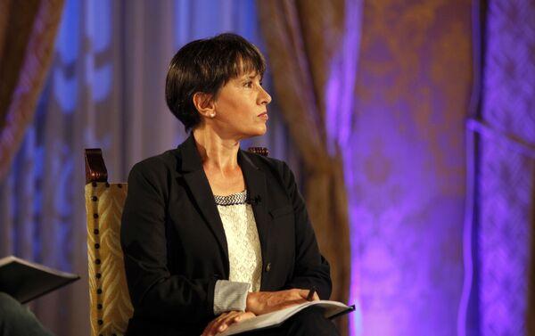Patricia Lee Wynne (Sputnik Mundo), durante la entrevista con el presidente de Ecuador, Rafael Correa - Sputnik Mundo