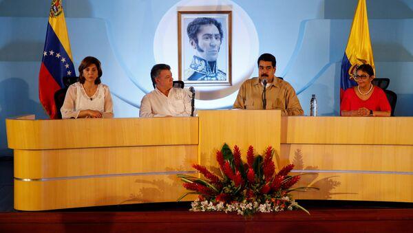 María Ángela Holguín, Juan Manuel Santos, Nicolás Maduro y Delcy Rodríguez - Sputnik Mundo